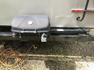 Rv bbq with mounting arm for bumper