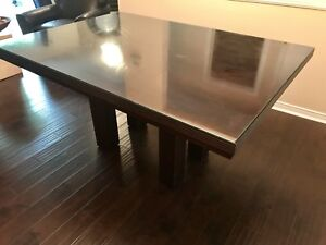 Well built dark wood dining table with glass top
