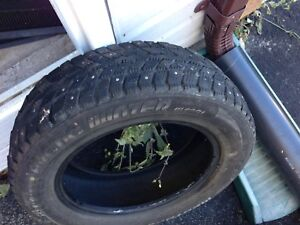 2 studded winter tires size 14