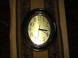 Telesonic Oval Wall Quartz Clock with Golden tone Rim Plastic Lens 10 x 12