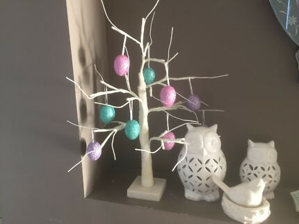 Artificial tree with Easter egg decorations