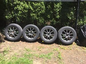 Four rims with snow tires - for 2012 Hyundai Genesis
