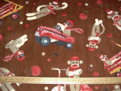 Old Sock Monkey ( Fleece Fabric Sock Monkey Toy Old Fashioned Car Wagon Trike on brown BTY)