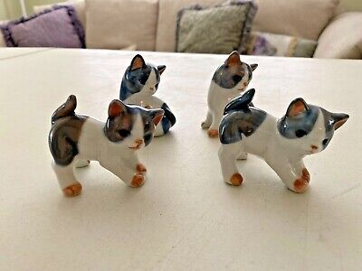 Set of four white & grey ceramic cats, circa 1960 by Cotagirl, made in Japan