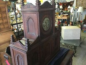 Very ornate Kienzel Movement Clock in oak case$1400