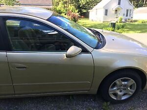 2002 Nissan Altima 2.5s and 2008 Volkswagen Golf city 2.0