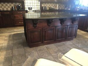 Beautiful kitchen island with granite counter top.