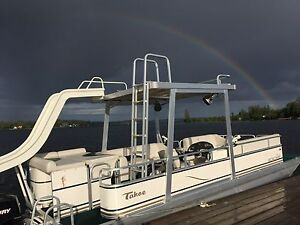 2008 Pontoon boat with waterslide, upper deck, camper top