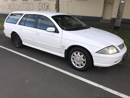 2002 White Ford Station Wagon