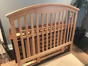 Wooden crib and mattress with anti stain covers and change pads