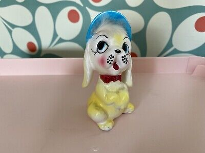 vintage kitsch yellow and blue dog with fur and cap