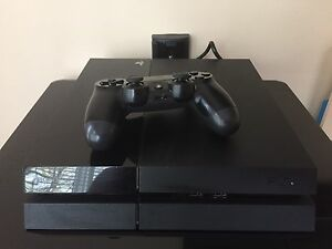 Sony PlayStation 4 with 4 games
