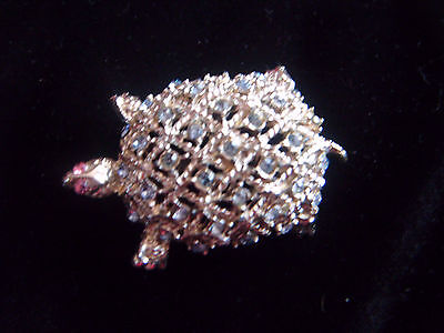 Beautiful silver tone and diamante turtle brooch with pink glass eyes.