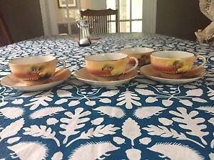 3 Hand Painted cup and saucers an 1 extra cup