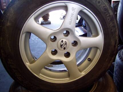 FORD AU & NEWER 15 INCH MAG WHEELS 2 OK TYRES 2 WORN TYRES BA BF Lonsdale Morphett Vale Area Preview