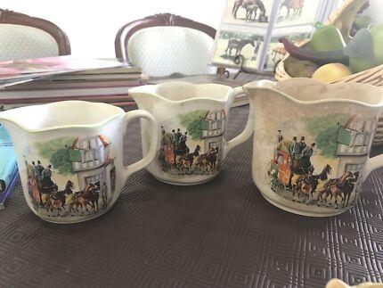 Antique milk or gravy jugs.