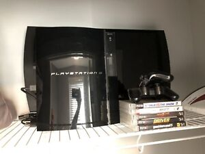 PlayStation 3, 2 remotes and 5 games.