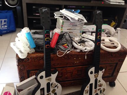 Wii console, controls, games,guns and guitars