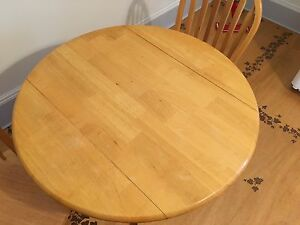 Wooden kitchen table and two chairs