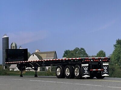 1/64 DCP BLACK 53' WILSON ROAD BRUTE TRI AXLE FLATBED TRAILER W/ BULKHEAD