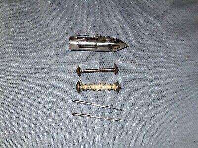 Original Jones CS Family shuttle, bobbins and round shank needles