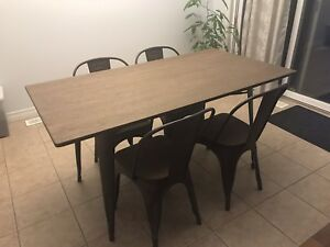 Rustic modern dining table with four chairs