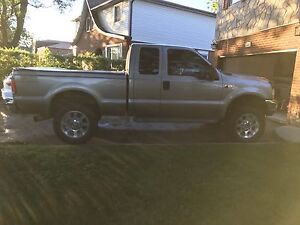 2004 Ford F350 extended cab 4 x 4 6.0L Diesel