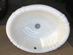 American Standard - clam shell top mount sink