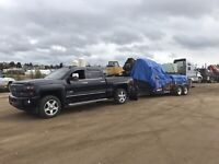 Truck and trailer available for hire.