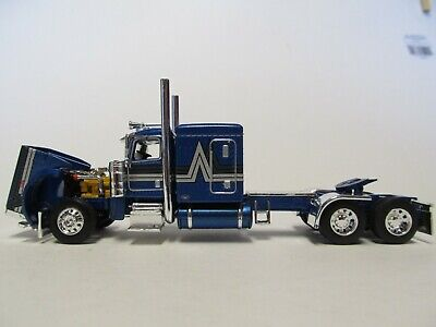 DCP FIRST GEAR 1/64 SCALE 389 PETERBILT FLAT TOP, BLUE WITH BLACK/ SILVER STRIPE 2