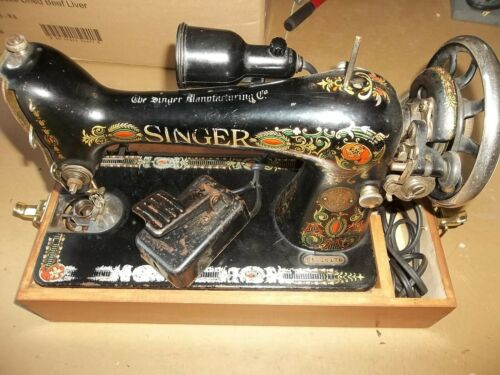 Singer sewing machine -1917 Red Eye Treadle Sewing Machine Model 66