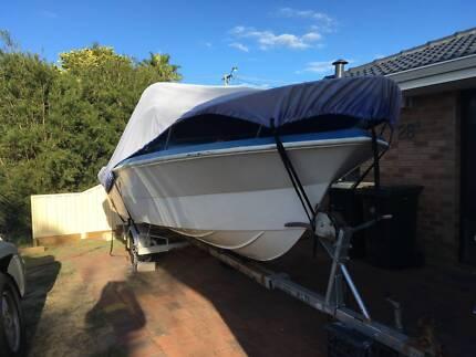 Boat - 5.2m fiberglass half cabin with trailer