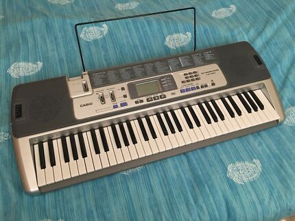 Casio LK100 keyboard with stand