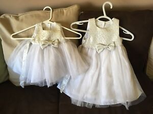 Matching white and silver dresses