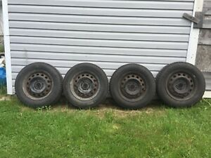 4  used 185/70/R14/88T General Altimax tires on steel rims