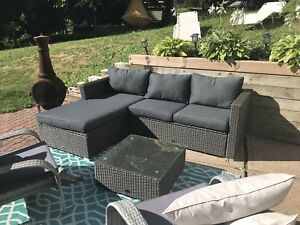 Brand new outdoor sectional sofa and coffee table.
