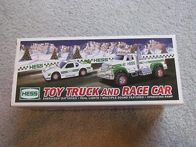 HESS NIB NEW MINT 2011 TOY TRUCK AND RACE CAR