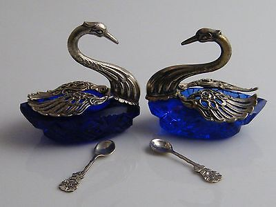 PAIR SILVER PLATED & BRISTOL BLUE GLASS SALT CELLARS IN SWAN FORM