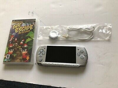 Sony PSP 3000 Silver Handheld System with 1 sealed game + remote control