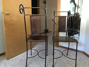 Wrought iron and leather chairs