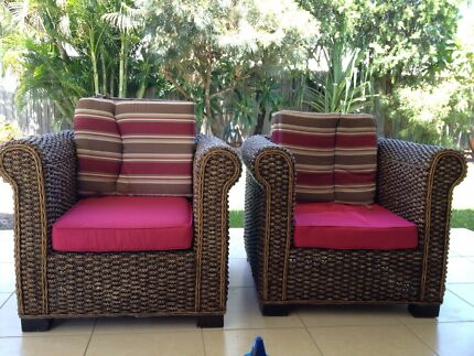 Two solid wicker armchairs/ indoor outdoor lounge chairs