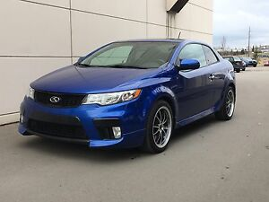 2011 Kia Forte SX Sport!  Low KMs, well maintained.  Blue.