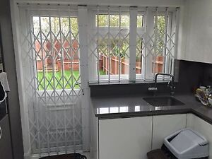 RETRACTABLE WINDOW SECURITY GRILLE, GRILL, GRILLES