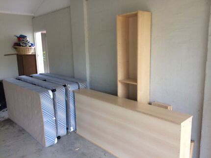 IKEA bookcases and single beds