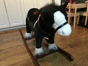 Plush rocking horse with movement and sound