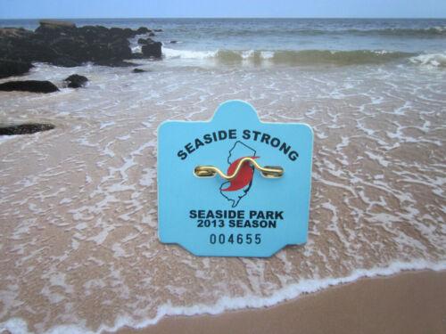 2013  SEASIDE  PARK  NEW JERSEY  SEASONAL BEACH  BADGE/TAG    8  YEARS  OLD