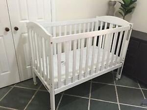 White timber cot with mattress Nerang Gold Coast West Preview