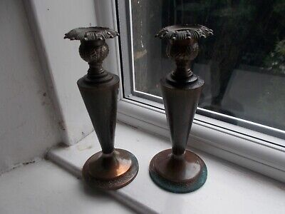 Vintage wooden candlesticks with copper holders and bases