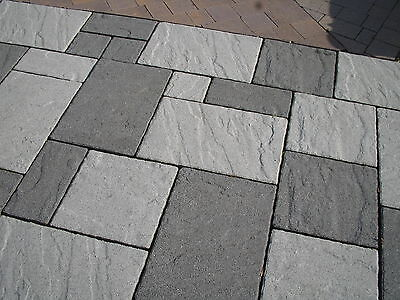 A mix of black granite and silver granite and also, a packed pallet...