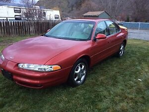 Oldsmobile intrigue! Leather!